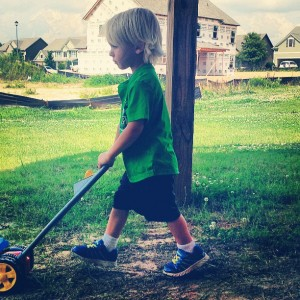Maddox mowing grass